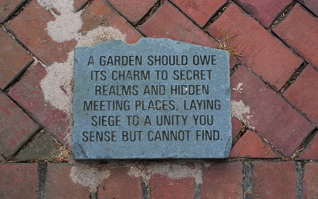 The Carlson's outdoor rooms are marked by stones carved with quotes about gardens and relationships.