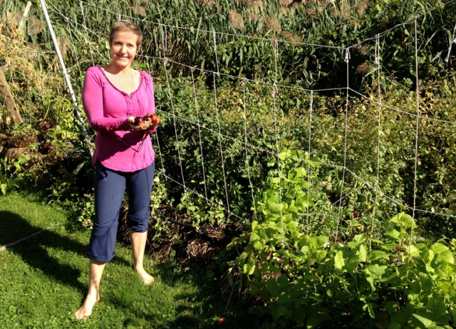 Elizabeth shows off her tomato crop